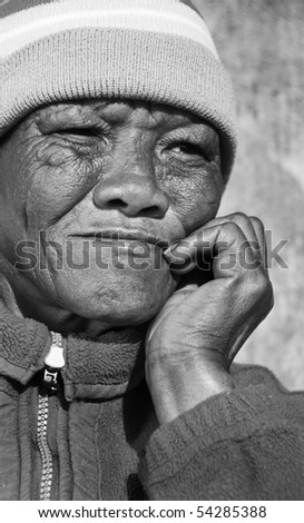 Senior African woman in black and white