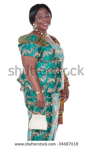 senior African woman with traditional Ghana clothing, green dress and white handbag - stock photo