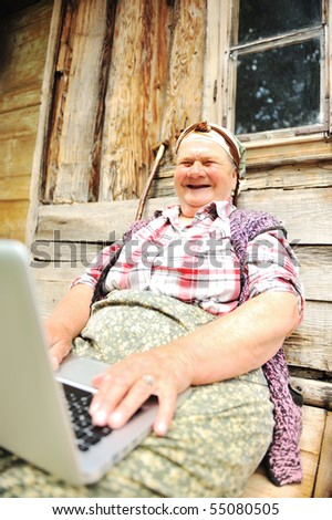 Senior aged woman with laptop - stock photo