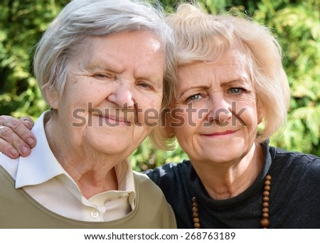 Senior and mature women in garden. MANY OTHER PHOTOS FROM THIS SERIES IN MY PORTFOLIO.  - stock photo