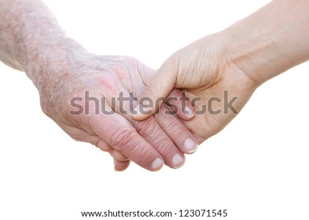 Senior and young hands on white background