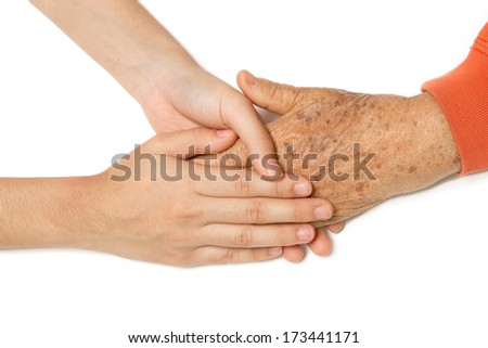 Senior and young holding hands together - stock photo