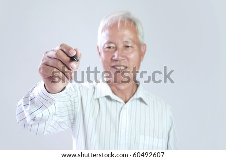 senior asian business man hodling a pen drawing