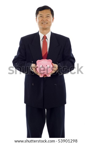 Senior Asian business man smiling and holding a piggy bank - stock photo