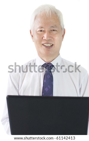 senior asian business man with a laptop - stock photo