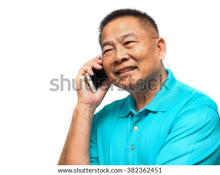 Senior Asian man smiling while talking on the phone isolated on white background.