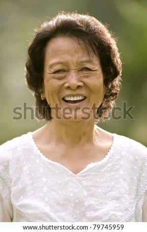 senior asian woman smiling - stock photo