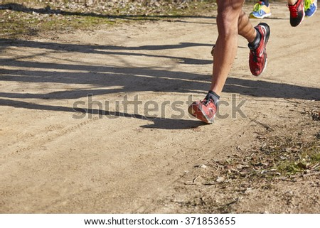Senior athletic runner detail. Outdoor circuit. Horizontal