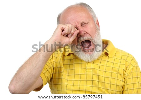 senior bald and bearded man is bored and yawning - stock photo