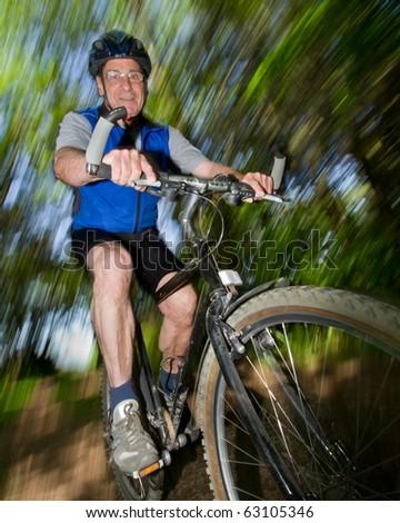 senior biking on a Mountain Bike - stock photo