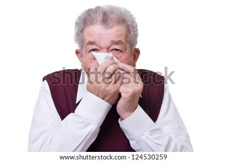 Senior blows his nose - stock photo