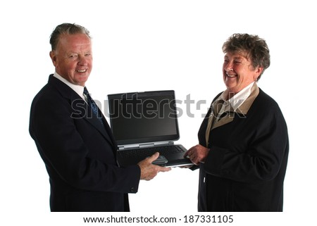Senior businesman fed up wtih younger assistant teaching him how to use the computer - stock photo