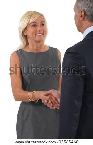 Senior business couple shaking hands - stock photo
