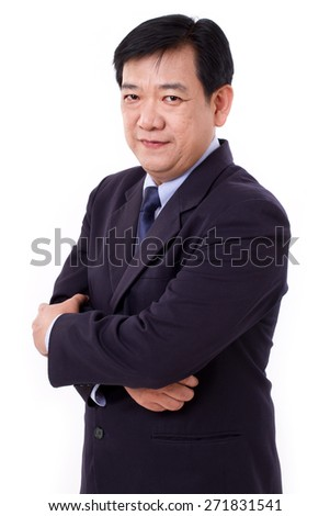 senior business executive crossing arms - stock photo