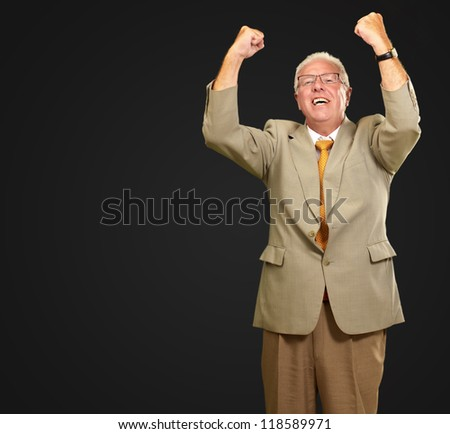 Senior Business Man Cheering Isolated On Black Background - stock photo