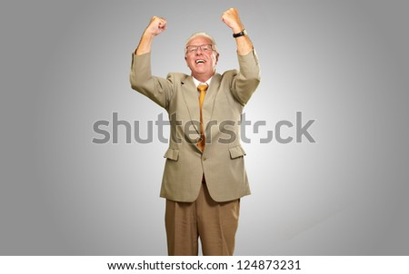 Senior Business Man Cheering Isolated On gray Background - stock photo