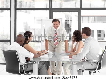 Senior Business man giving a presentation to a group of people - stock photo