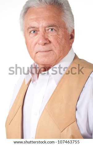 senior business man in leather vest - stock photo