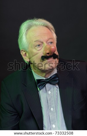 Senior business man in suit with party nose. - stock photo