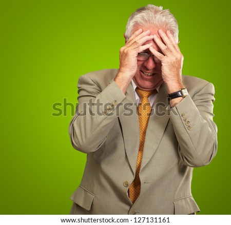 Senior Business Man In Tension Isolated On Green Background - stock photo