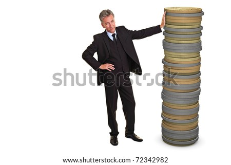 Senior business man leaning an a huge stack of Euro coins - stock photo