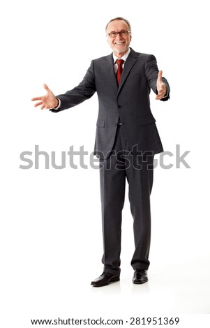 senior business man says welcome with his arms - stock photo