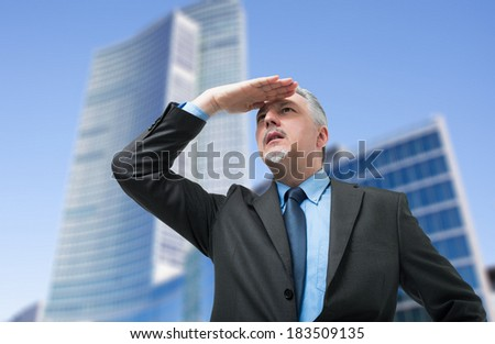 Senior business man searching new opportunities for his company