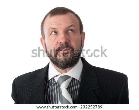 senior business man thinking in the office - stock photo