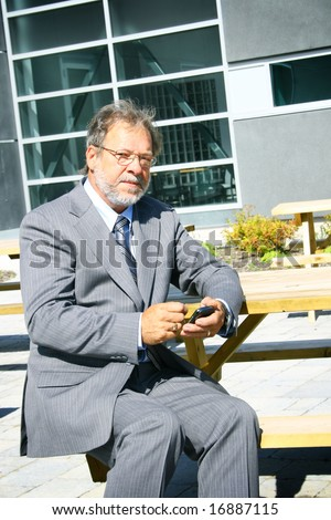 Senior business man using pocket computer