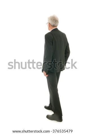 Senior business man walking away - stock photo