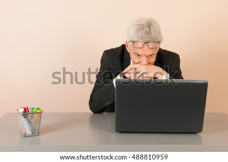 Senior business man with laptop