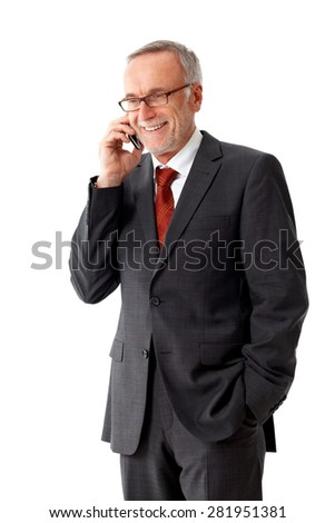 Senior business man with mobile phone and a pair of glasses