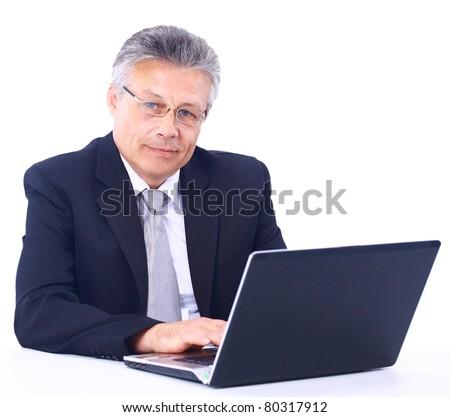 Senior business man working on laptop - stock photo