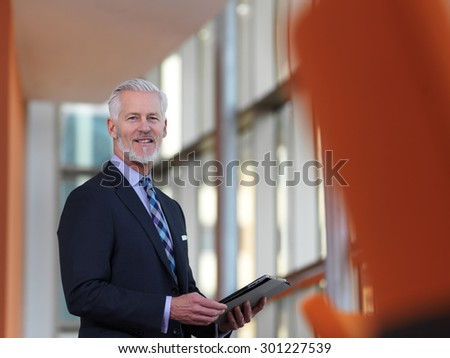 senior business man working on tablet computer at office - stock photo