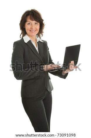 Senior business woman using laptop - stock photo