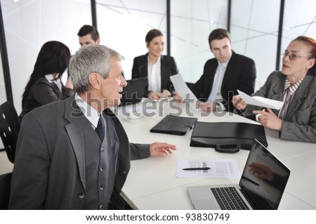 Senior businessman and businesswoman at a meeting. Open discussion between colleagues