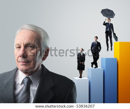 senior businessman and his team on 3d stat background - stock photo