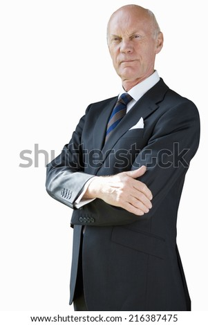 Senior businessman, arms crossed, cut out - stock photo