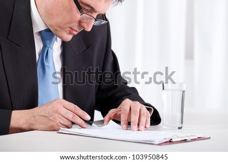 Senior businessman concentrate reading and  checking contract - stock photo