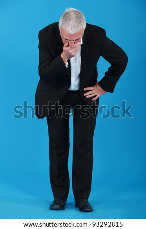Senior businessman doesn't look well - stock photo
