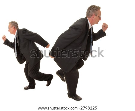 Senior businessman going in two different directions at the same time - stock photo
