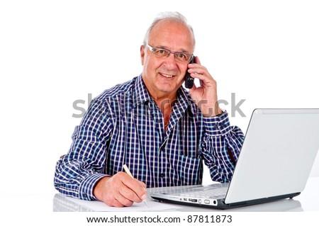 senior businessman has fun at work - stock photo