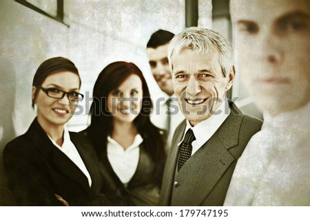 Senior businessman having discussion with younger colleagues at work