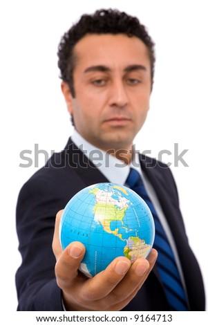 senior businessman holding a mini globe, shallow dof - stock photo