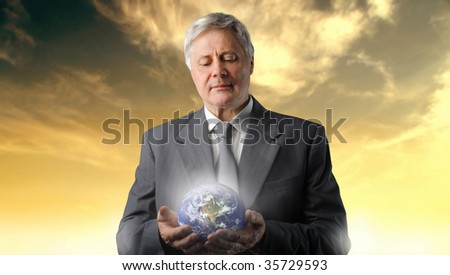 senior businessman holding planet earth