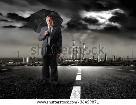 senior businessman holding umbrella under a toxic rain - stock photo