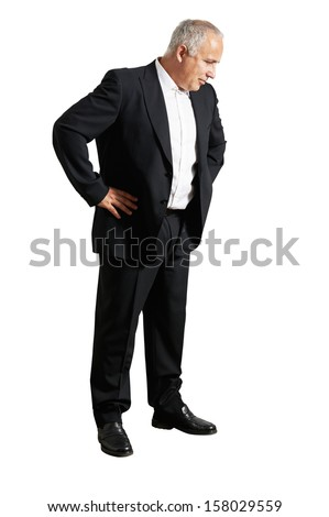 senior businessman in black suit looking down. isolated on white background - stock photo