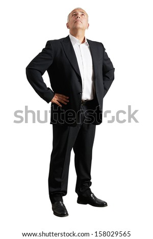 senior businessman in black suit looking up. isolated on white background - stock photo