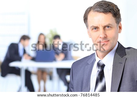 senior businessman in office - stock photo