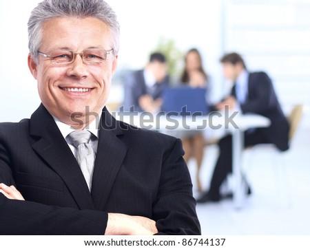 senior businessman in office - stock photo